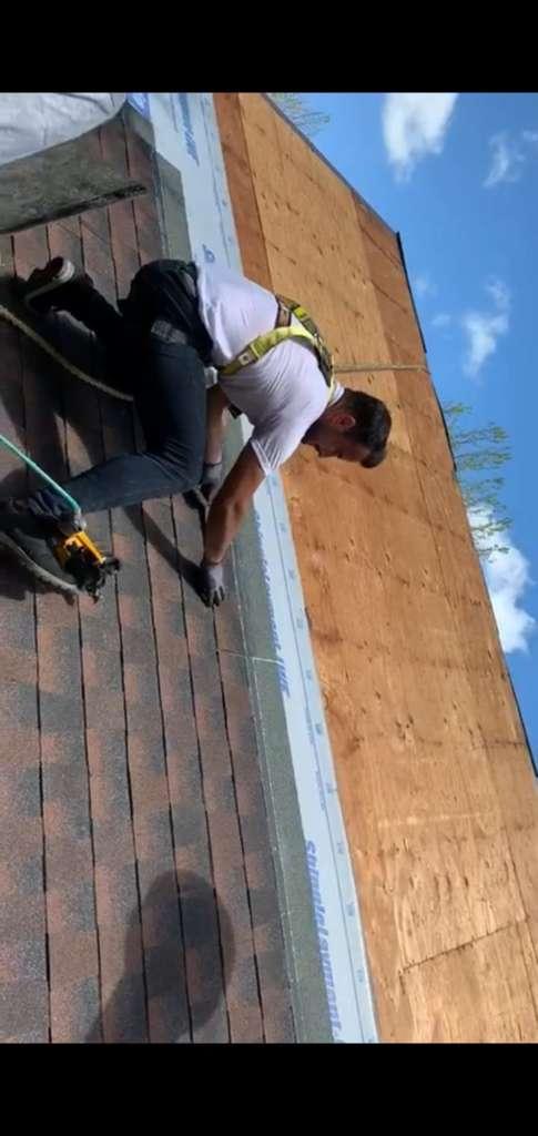 RH Professionals Repairing Gutters