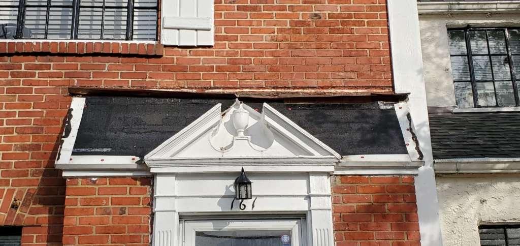 Ripped Shingle Above Entrance