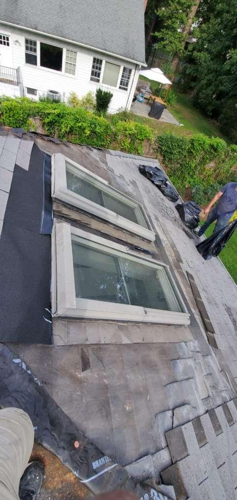 Ripped Shingle Above Roof Window