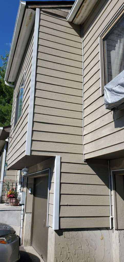 Ripped Shingle Home Exterior
