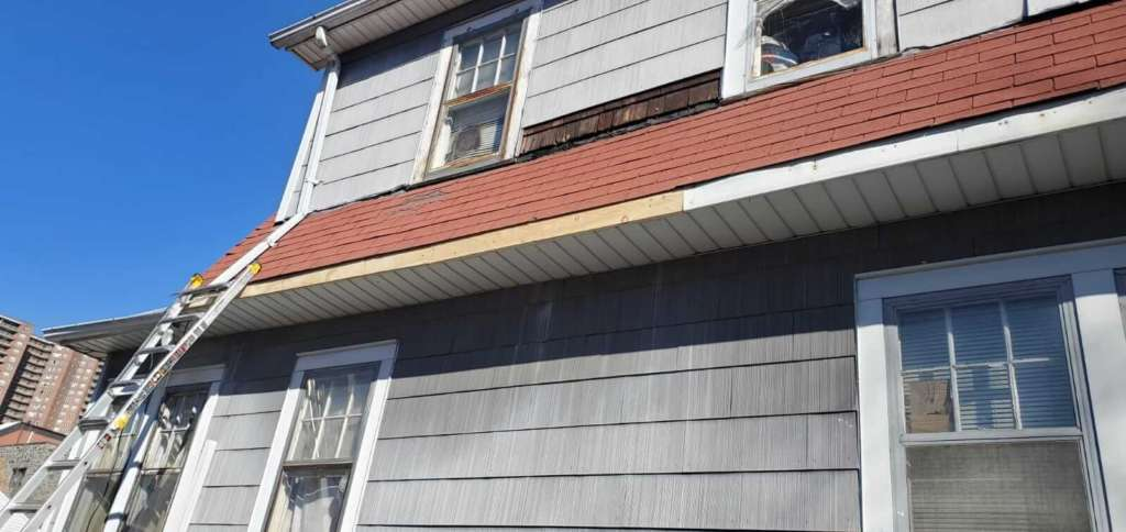 Wood Change & New Gutters Installation