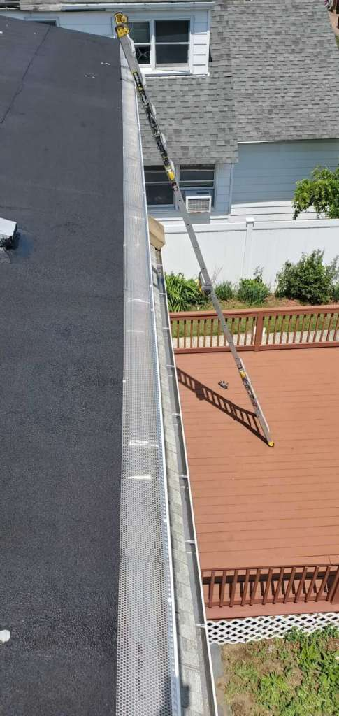 Project: New Gutters Siding Flat Roof Service Project Shot 1