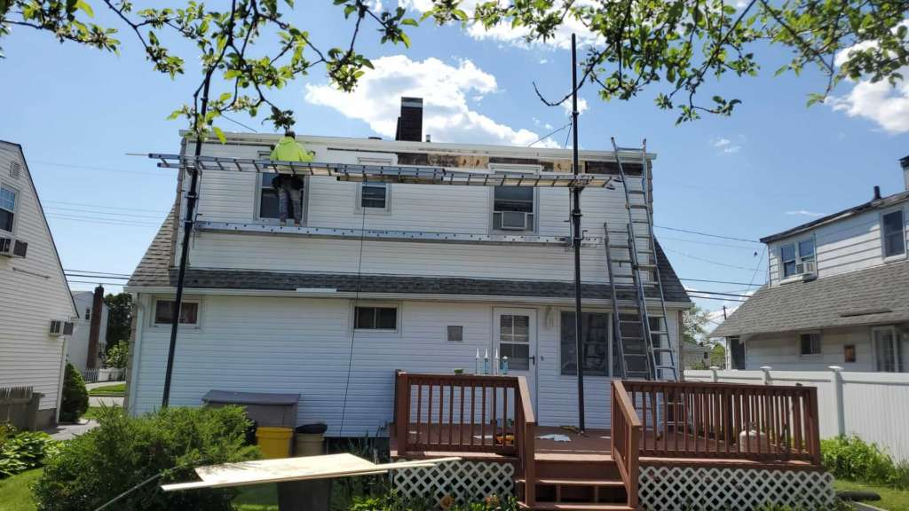 Project: New Gutters Siding Flat Roof Service Project Shot 14