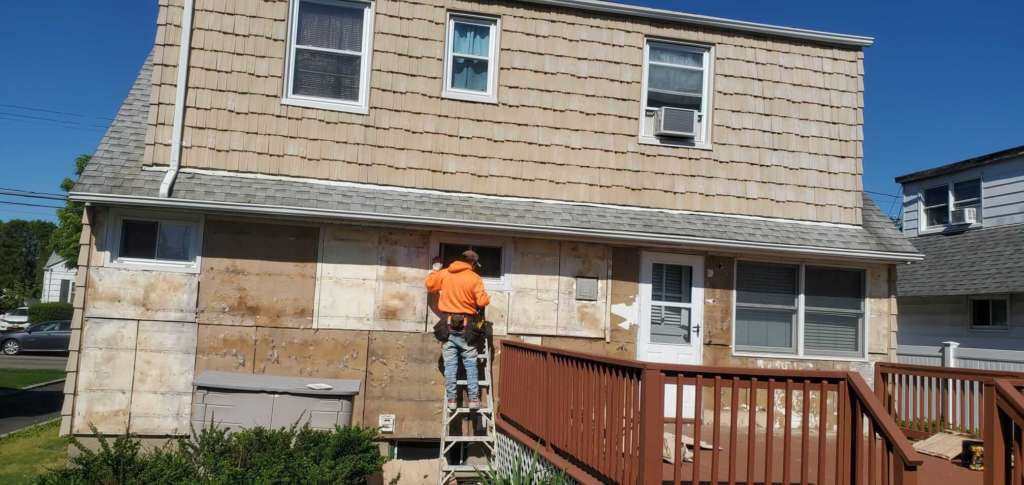 Project: New Gutters Siding Flat Roof Service Project Shot 9