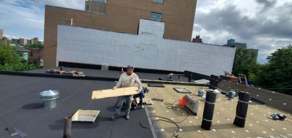 Flat Roof Installation, New Skylight, New Gutters and New Shingle Project Shot 1