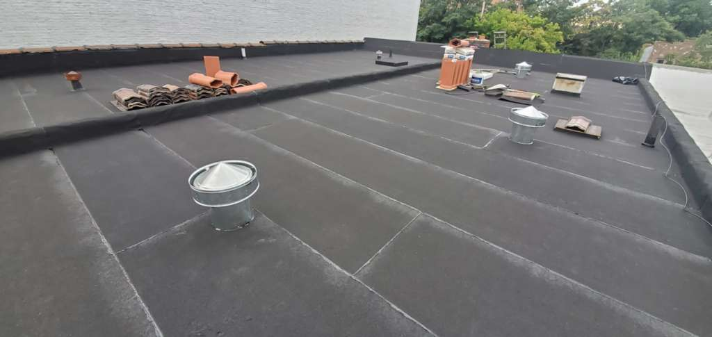 Flat Roof Installation, New Skylight, New Gutters and New Shingle Project Shot 3