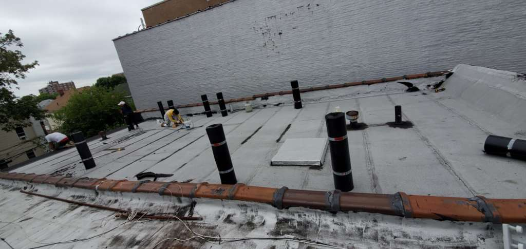 Flat Roof Installation, New Skylight, New Gutters and New Shingle Project Shot 8