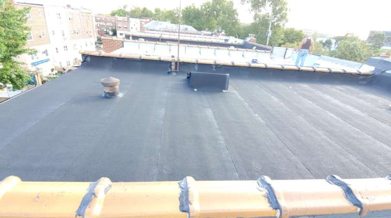 Installed a New Layer Over the Existing Flat Roof Project Shot 2